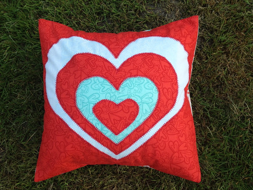 reverse applique love heart cushion by Samantha Halliwell