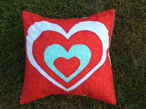 reverse applique love heart cushion by Samantha Halliwell