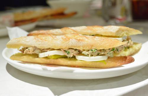 José's Tuna Salad a salad of preserved tuna, mayonnaise, shallots and hard boiled eggs on flauta bread