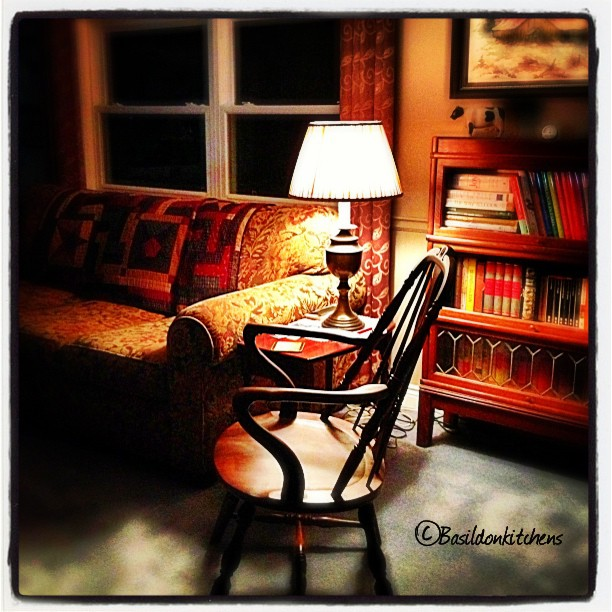 June 4 - after dark {my favorite reading corner} Looks inviting, doesn't it? #TitleFx #fmsphotoaday #nook #maneatingsofa #livingroom #comfy