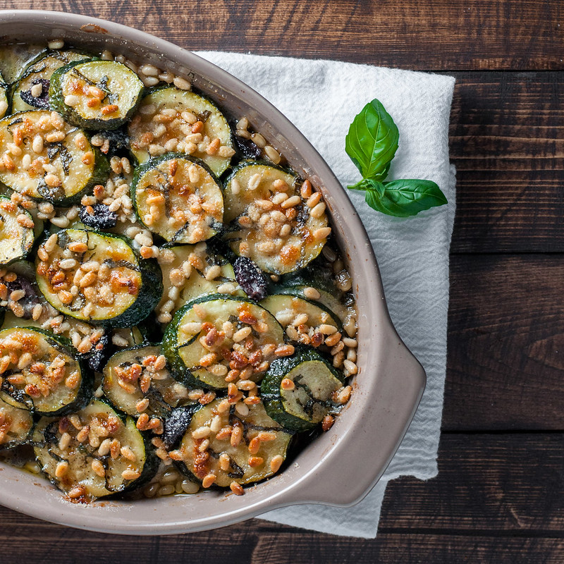 Gluten-free mediterranean zucchini gratin with mozzarella and toasted pine nuts