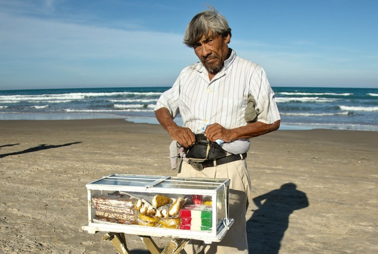 Mexican candy salesman at the beach