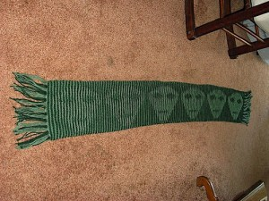 Green Alien Illusion Scarf showing the alien heads