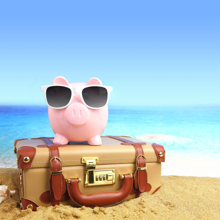 Piggy bank travel (stock)
