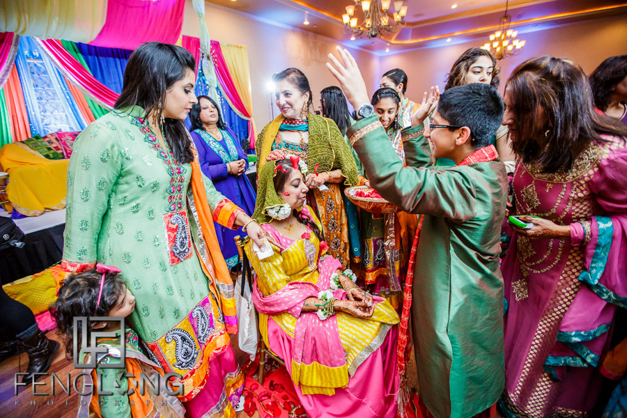 Throwing rose petals on the Indian bride