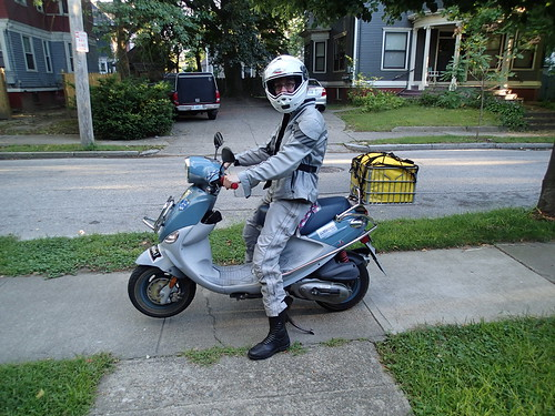 arriving home on the Buddy scooter with a custom milkcrate bag stuffed with groceries