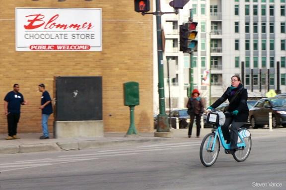 Woman using a Divvy bike