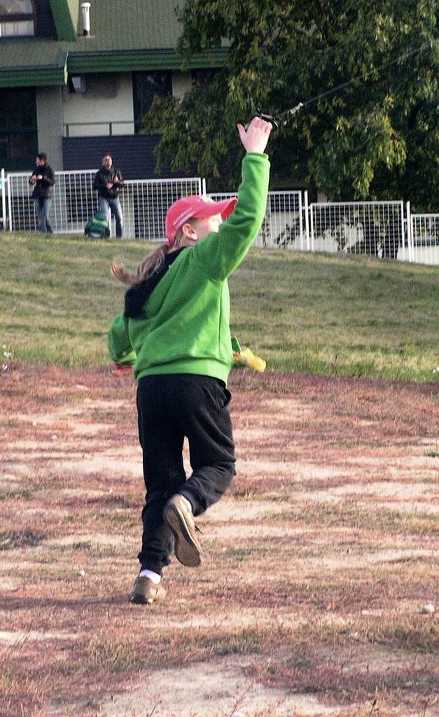 Girl in Green Flying the Kite 3