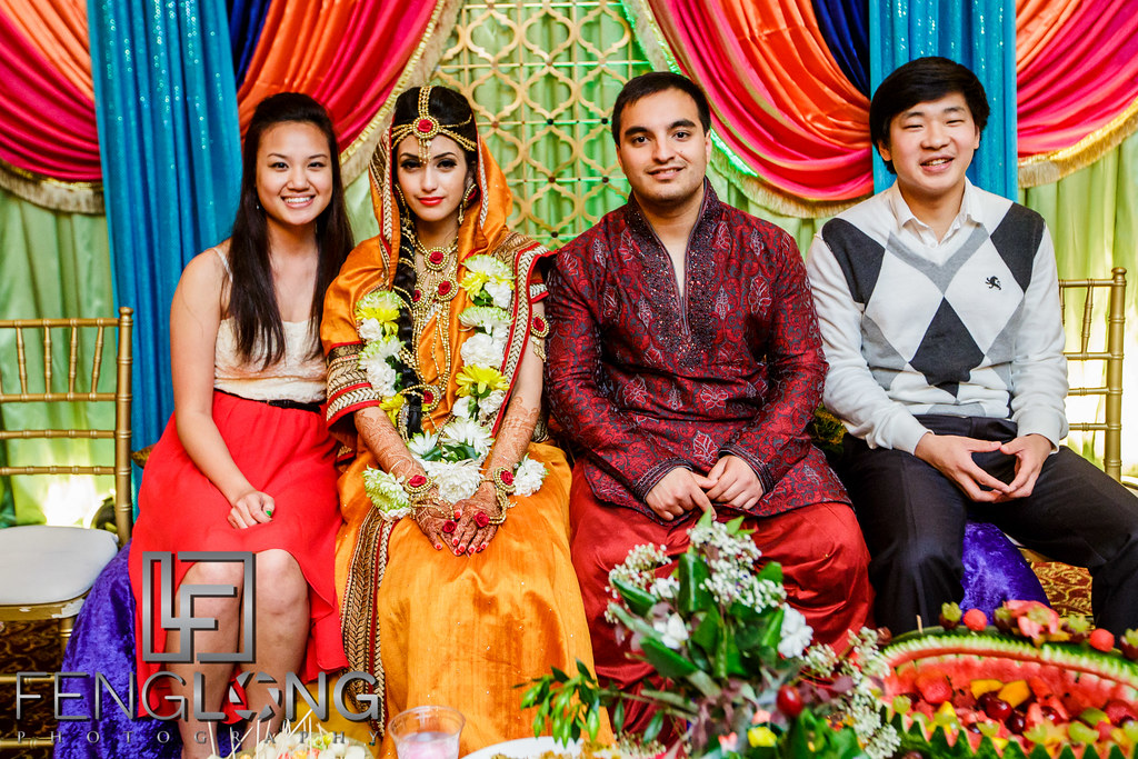 Bride and groom take photos with friends