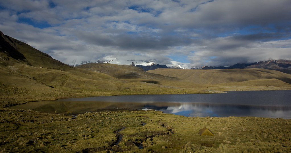 Another lonely bivaouc at Laguna Huecracocha, while the Andes awakes. How desolate these wild places are above 4000m, the flora cannot recover, because overgrazing is still a huge ecosystem corrupter, even after almost 40 years of conservation. Huascaran National Park. Cordillera Blanca. Peru.