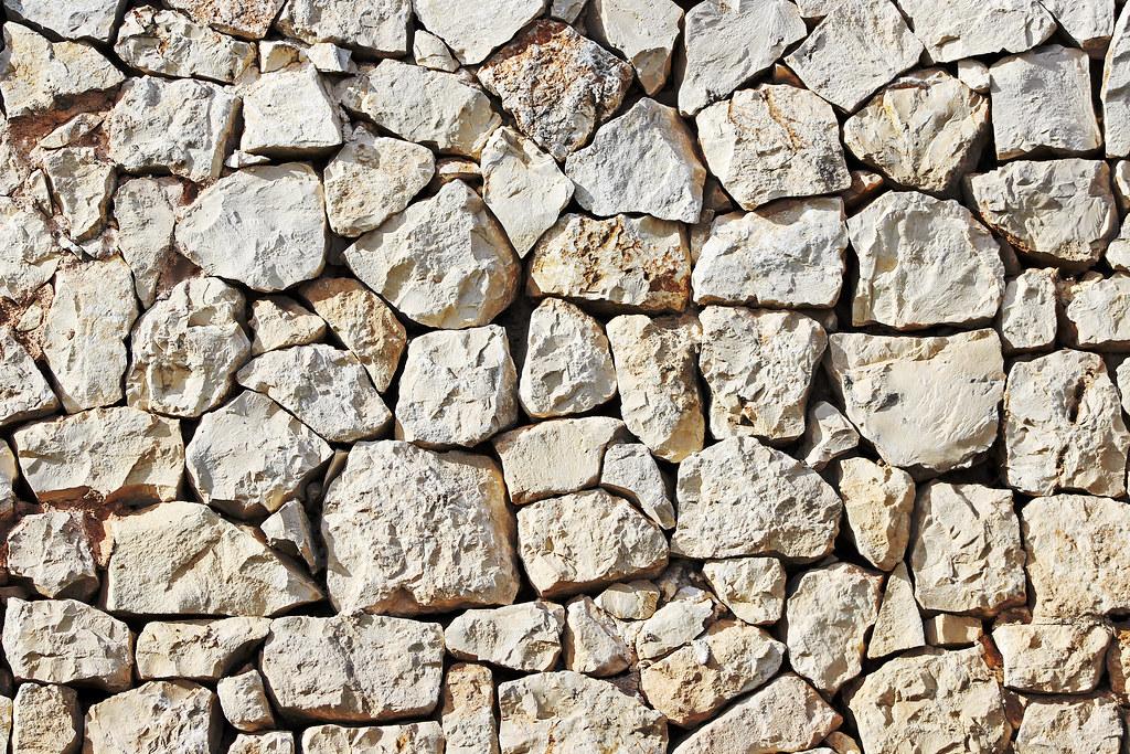 Foto gratis de una pared de piedra blanca