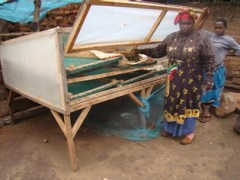 Mrs Lukumay with her daughter explaining how they dry amaranth seeds for sowing in the coming season using a direct solar dryer (Photo credit: AVRDC / Inviolate Mosha)
