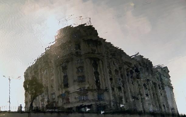 Building river reflection - Dâmbovi?a river, Bucharest