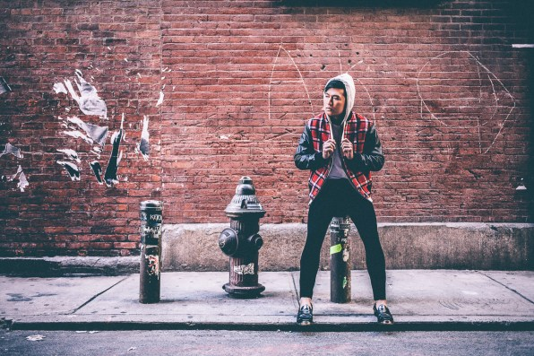 Bryanboy sitting on Fire Hydrant posts in Soho, New York City