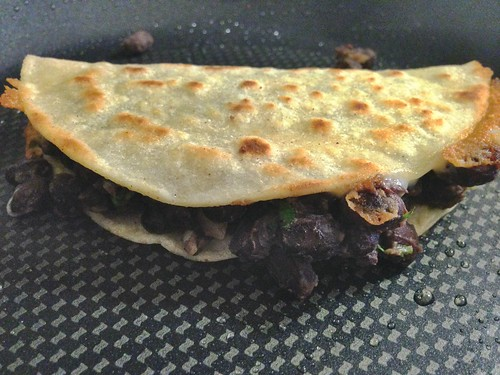 crunchy black bean tacos in the pan