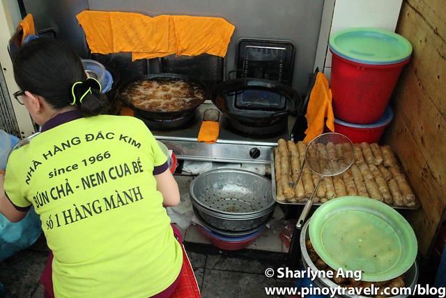 Woman Frying Vietnamese Spring Rolls