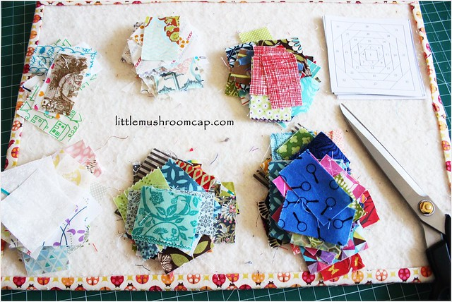 Prepping for sewing pineapple paper-pieced blocks - 3 dark values and light value piles