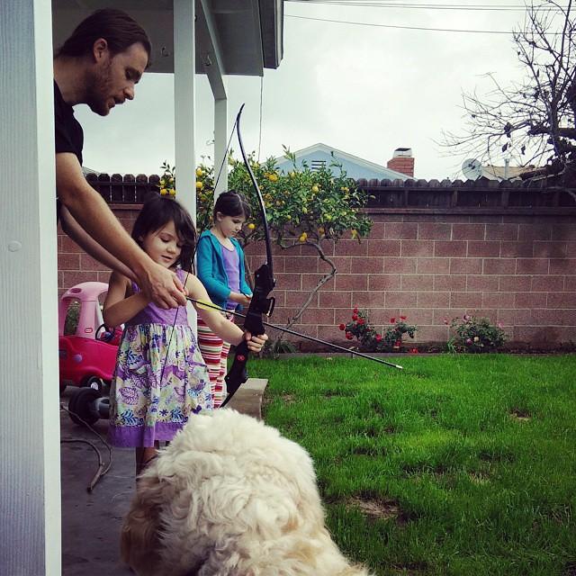 Rainy Sunday backyard archery lessons...