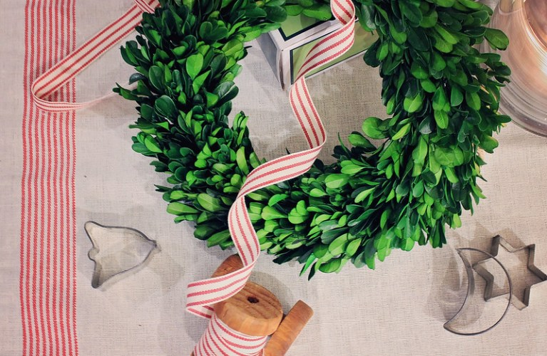 Boxwood wreath, cookie cutters, striped red and white ribbon - christmas magic (Christmas Preparation)