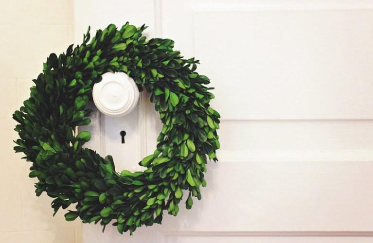 DIY Christmas Decor - Boxwood Wreath hanging off door knob