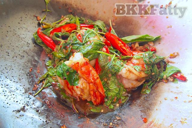 steaming hot thai basil in wok at jay fai