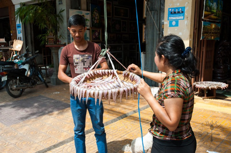 Locals drying the fish