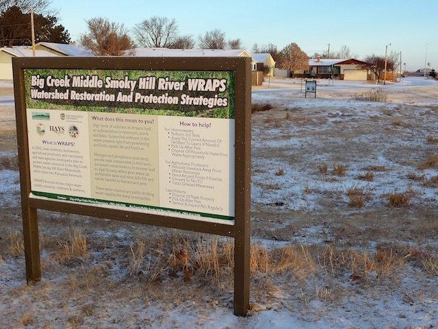 WRAPS signs 2 behind Day's Inn, Hays, KS Dec 2014