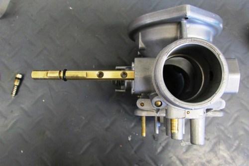 Inserting Throttle Shaft Into Carburetor