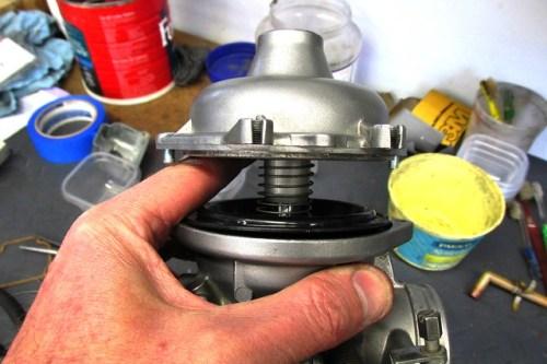 Throttle Slide Spring Installed Under Carburetor Top Dome