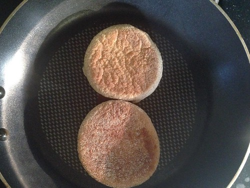 English muffin getting toasted in the pan