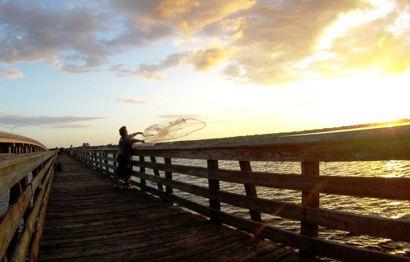 Throwing a cast net for bait fish at the El Jobean Fishing Pier in Port Charlotte, Fla.