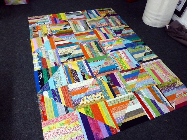 Bee blessed Scrappy triangles quilt top