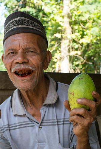 Avocado man. Bena village, Bajawa, Flores