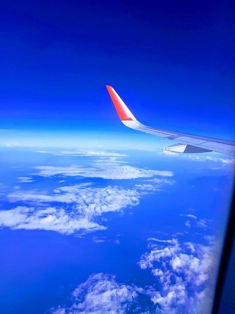 Shot of a plane wing while in the air