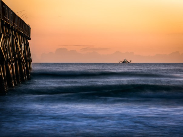 "Fishing trawler ""Miss Hope"" at daybreak near the pier"