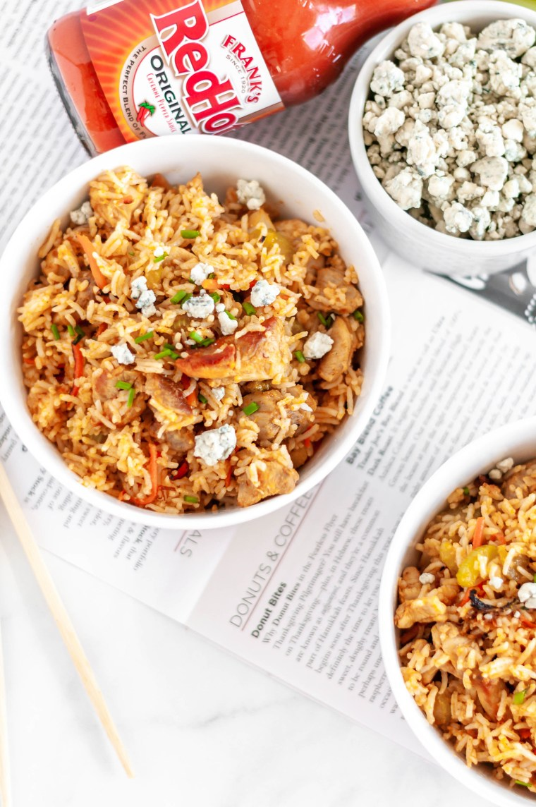 Buffalo Fried Rice is a super simple, flavorful and spicy dinner you can whip up in less than 30 minutes with some leftover rice. Spicy buffalo chicken, carrots, celery and buffalo sauce with a sprinkle of crumbled blue cheese.