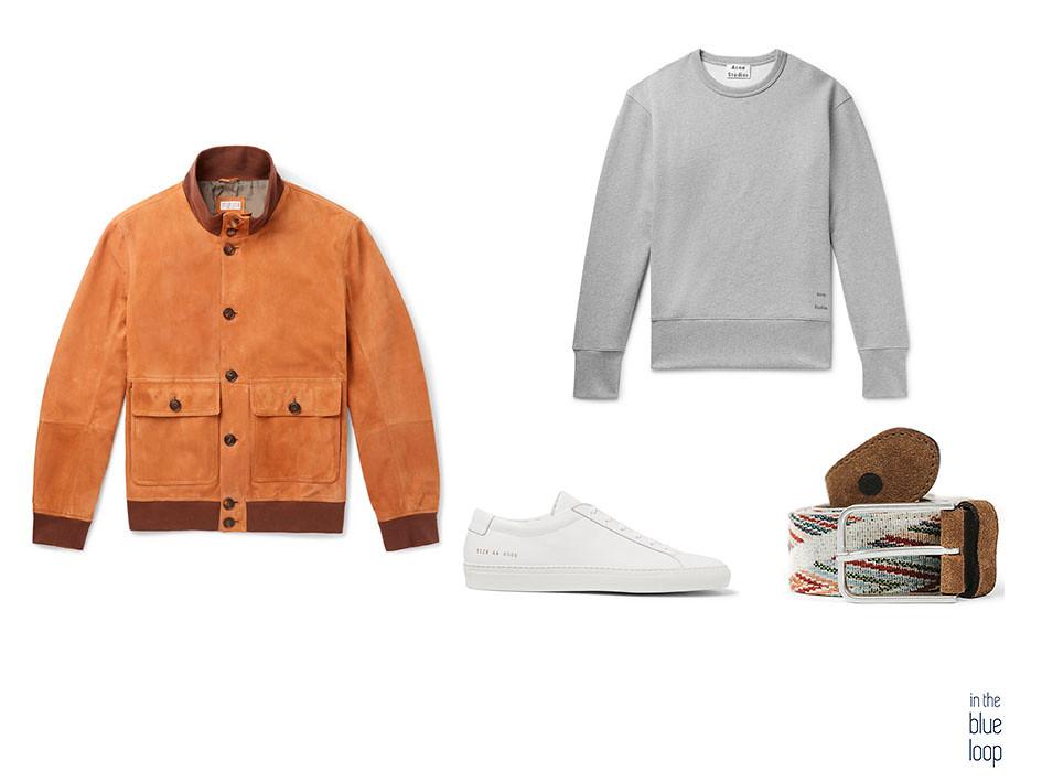 Casual hombre con chaqueta, sweater, cinturón arure de blue hole y sneakers blancas