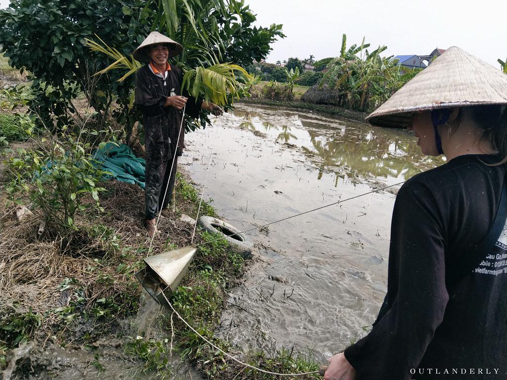 scooping-water-viet-farm-trip