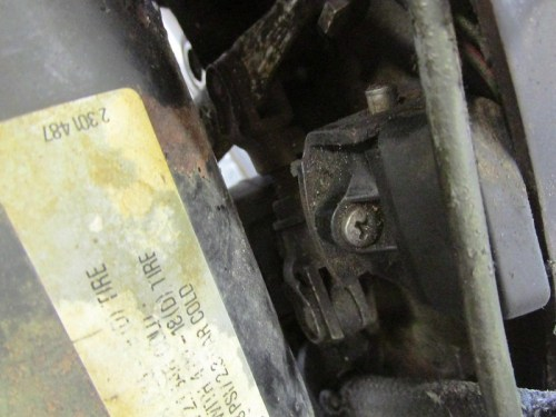 Rear Brake Light Switch Mounts to Tab On Inside of Right Muffler Bracket