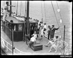 Group of people on the deck of a sailing vesse...