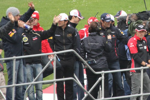 The drivers on the Formula One Drivers' Parade at the 2012 British Grand Prix at Silverstone