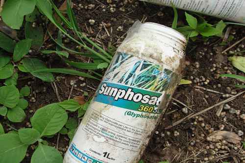 Used container of herbicide in farmer field ca...