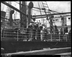 View of SS MONTORO showing six crewmen leaning...