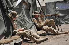 Soldiers Relaxing and Reading Books During Exe...