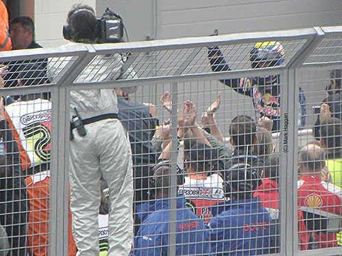 Sebastian Vettel gets out of his car after winning the 2009 British Grand Prix