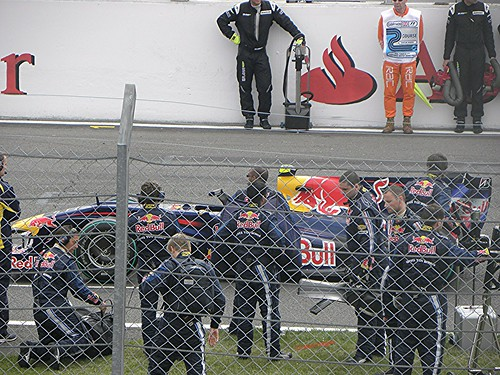 The Red Bull Racing team prepare Sebastian Vettel's car for the 2009 British Grand Prix
