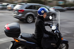 Young woman riding a scooter in Roma