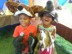 Kids playing dress-up at a children's fai