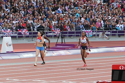 Margaret Adeoye of Team GB and Aleksandra Fedoriva of Russia finish their heat for the 200m at the London 2012 Olympics