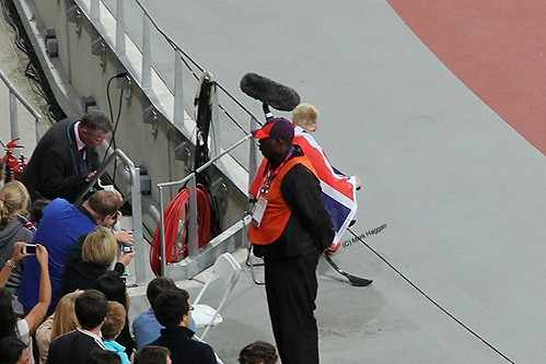 Jonnie Peacock watches the next race during his victory lap after winning the men's T44 100m at the London 2012 Paralympic Games